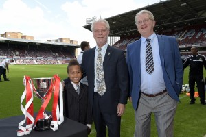 Pitchside with David Gold and nephew Michael