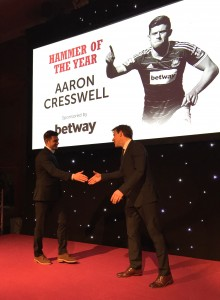 Aaron Cresswell coming up to receive his 'Hammer Of The Year' Award
