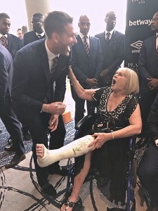 Patricia getting her 'cast' signed by Adrian