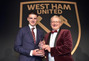 Peter presenting Declan Rice with his award
